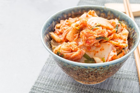 Kimchi cabbage. Korean appetizer in a bowl, horizontal, copy space