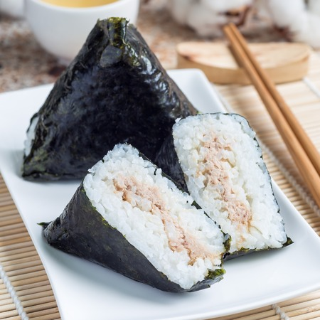 Korean triangle kimbap Samgak made with nori, rice and tuna fish, similar to Japanese rice ball onigiri, square format