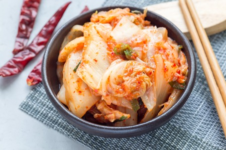 Kimchi cabbage. Korean appetizer in a ceramic bowl, horizontal