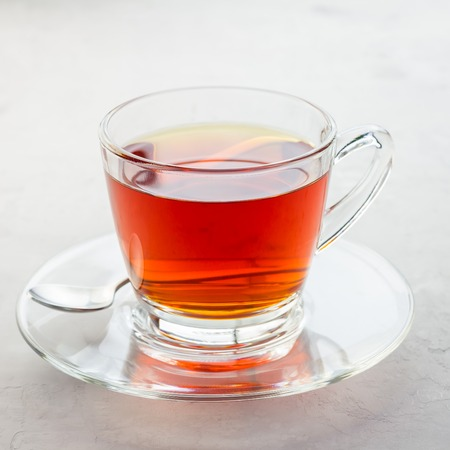 Healthy herbal rooibos red tea in glass cup, square format