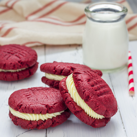 Red velvet sandwich cookies with cream cheese filling, square format Stock Photo