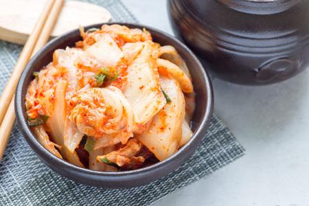 Kimchi cabbage. Korean appetizer in a ceramic bowl, horizontal