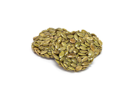 Korean traditional sweet snacks with pumpkin seeds, isolated on a white