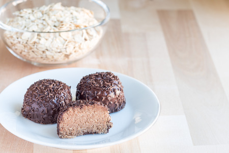 Swedish sweets Arrack balls, made from cookie crumbs, cocoa, butter and coconut wine Arrack flavour, horizontal copy space