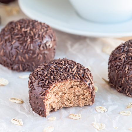 Swedish sweets Arrack balls, made from cookie crumbs, cocoa, butter and coconut wine Arrack flavour, square format Stock Photo