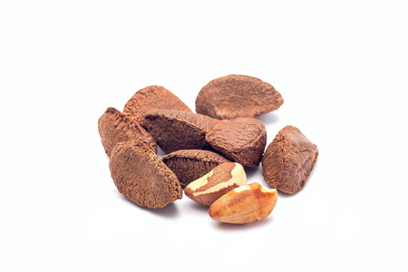 Group of brazil nuts in a shell isolated on a white background