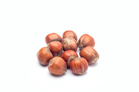 Group of hazelnuts in a shell isolated on  white background Stock Photo - 124566181