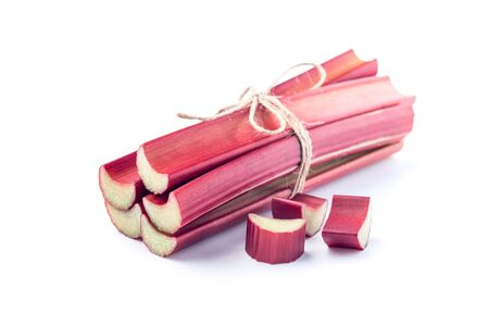 Whole sticks of rhubarb in a bundle with few piece of cut rhubarb, isolated on  white background 版權商用圖片