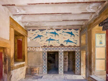 Old walls with Dolphin fresco, symbol of minoan culture. Knossos palace ruins at Crete island, Greece. Famous Minoan palace  of Knossos Stock Photo - 130113620