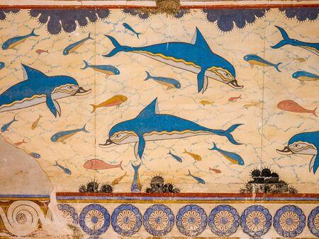 Dolphin fresco, symbol of minoan culture. Knossos palace ruins at Crete island, Greece. Famous Minoan palace of  Knossos Stock Photo - 130113721