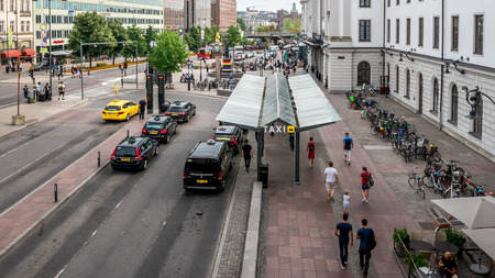 Taxi cars waiting on the stop near the main rail station or Centralstation in Stockholm, Sweden,  13 august 2018