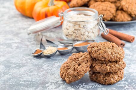 Spicy pumpkin and oatmeal cookies on the table and on cooling rack, horizontal, copy space