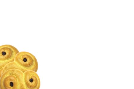 Traditional Swedish and scandinavian Christmas saffron buns Lussekatter, three in the corner, isolated on a white background, horizontal