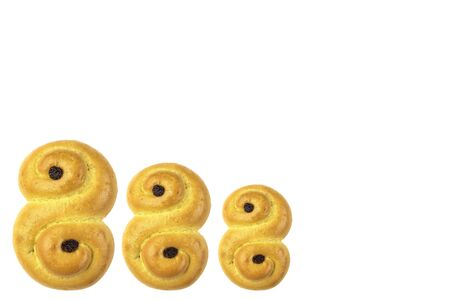 Traditional Swedish and scandinavian Christmas saffron buns Lussekatter, three in the row, isolated on a white background, horizontal Zdjęcie Seryjne - 138358161