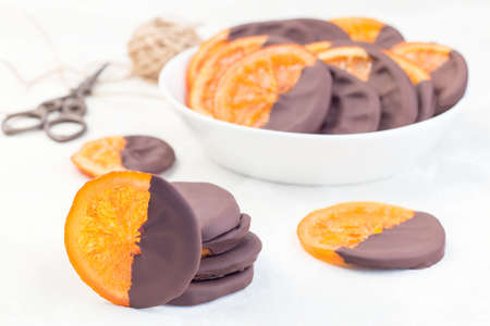 Homemade candied sliced oranges covered with chocolate, horizontal