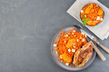Healthy meal, roasted chicken breast with carrot, chickpeas, feta cheese salad, horizontal, top view,  copy space