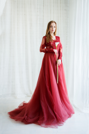 bride in an red gown with calla flower in hands