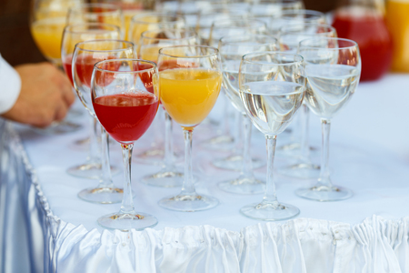 Glasses in a row at a buffet table Stock Photo