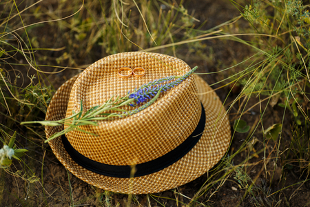 sunhat: straw hat with wildflowers in a field