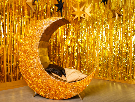 Golden lounger in the form of moon decorated for the new year