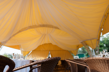 beautifully decorated wedding tent and wedding banquet on a background of sky Stock Photo