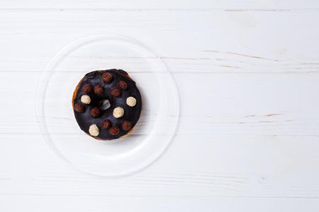 donut in sugar glaze on transparent plate
