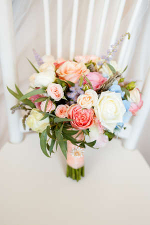 Wedding bouquet of sweet roses and other beautiful flowers