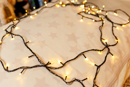 Christmas background. Festive abstract background with bokeh defocused lights and stars Stock fotó