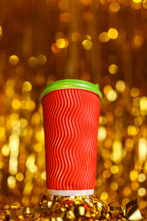Coffee to go in red cup and Christmas golden metafan
