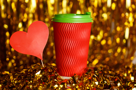Coffee in red cup with marshmallow and Christmas golden metafan