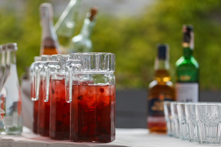 Decanters with cranberry lemonade and ice