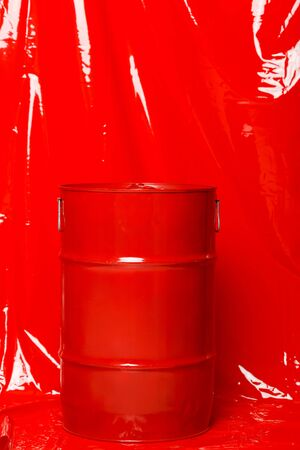 Red barrel on a red latex background Imagens