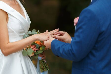 Newlyweds put each other rings on the ceremony