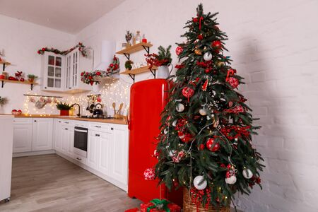 Christmas decorated kithen in loft style. Red colors. Modern loft style of interior dacorated for New Year Eve