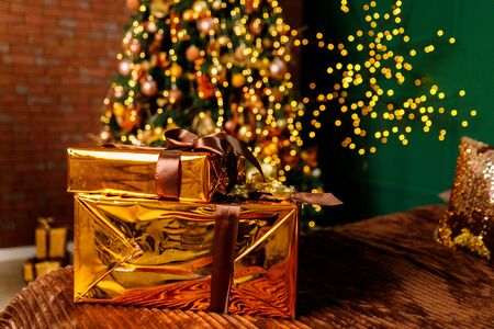 Golden Boxes Of Presents Under The Christmas Tree