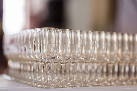 Empty glasses for wine and champagne in a row at the banquet table