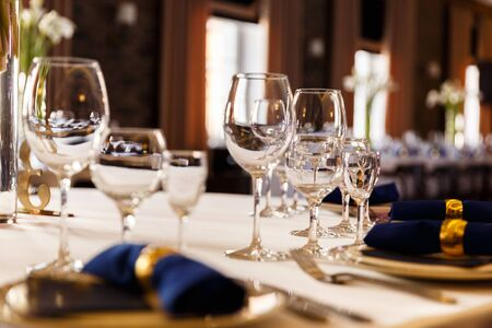 Wine glasses and champagne flutes on table, Wedding decor. Selective focus