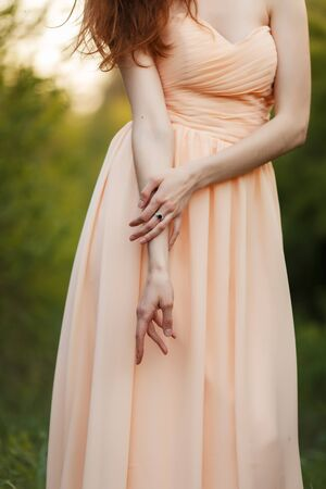 Bride's hands with white gold engagement ring 免版税图像