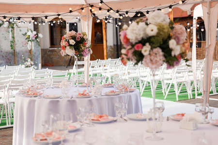 Table Setting at a Luxury Wedding Reception. Wedding reception place ready for guests. Luxury wedding dining table setting in a restaurant.