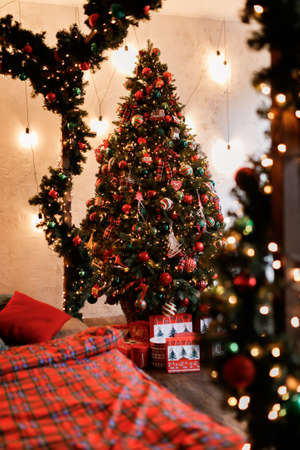 Christmas Balls And Decorations On A Beautiful Christmas Tree. Decorated Christmas Interior. Place For Text. 免版税图像