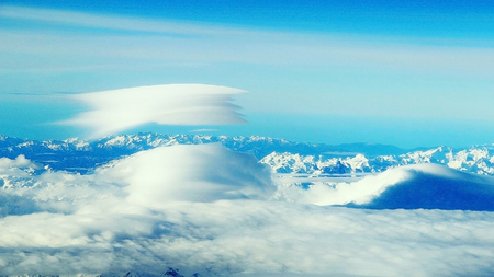 A natural phenomenon - oblique multilayered cloud above the mountains.