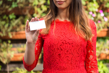 Young businesswoman shows business card