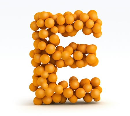 Letter E, font of orange citrus fruits on white background photo