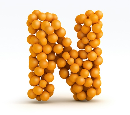 Letter N, font of orange citrus fruits on white background photo