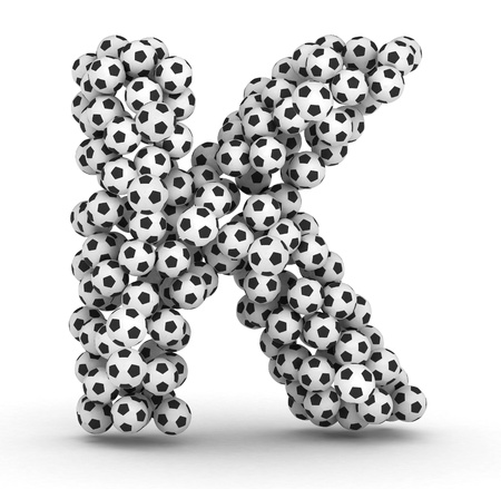 Letter K from soccer football balls isolated on white background photo