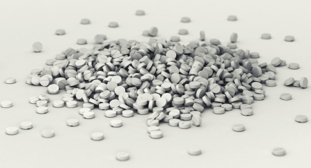 public health: Big heap of pills scattered on the ground