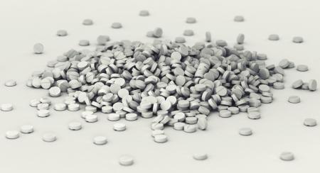 salud publica: Gran montón de píldoras esparcidas por el suelo