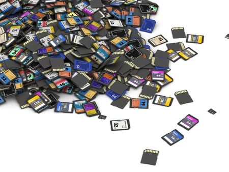 sd: Heap of different SD and microSD memory cards  fictitious brand