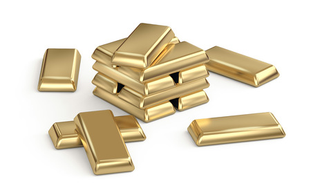 Shiny gold bars stacked an scattered on white background photo