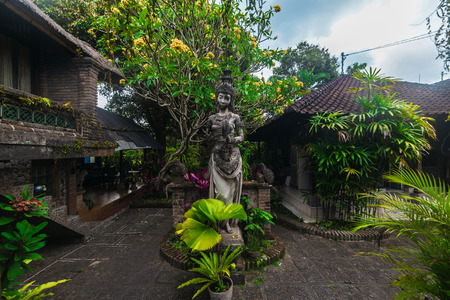 balinese: Traditional Balinese sculpture woman statue in Ubud, Bal, Indonesia Stock Photo